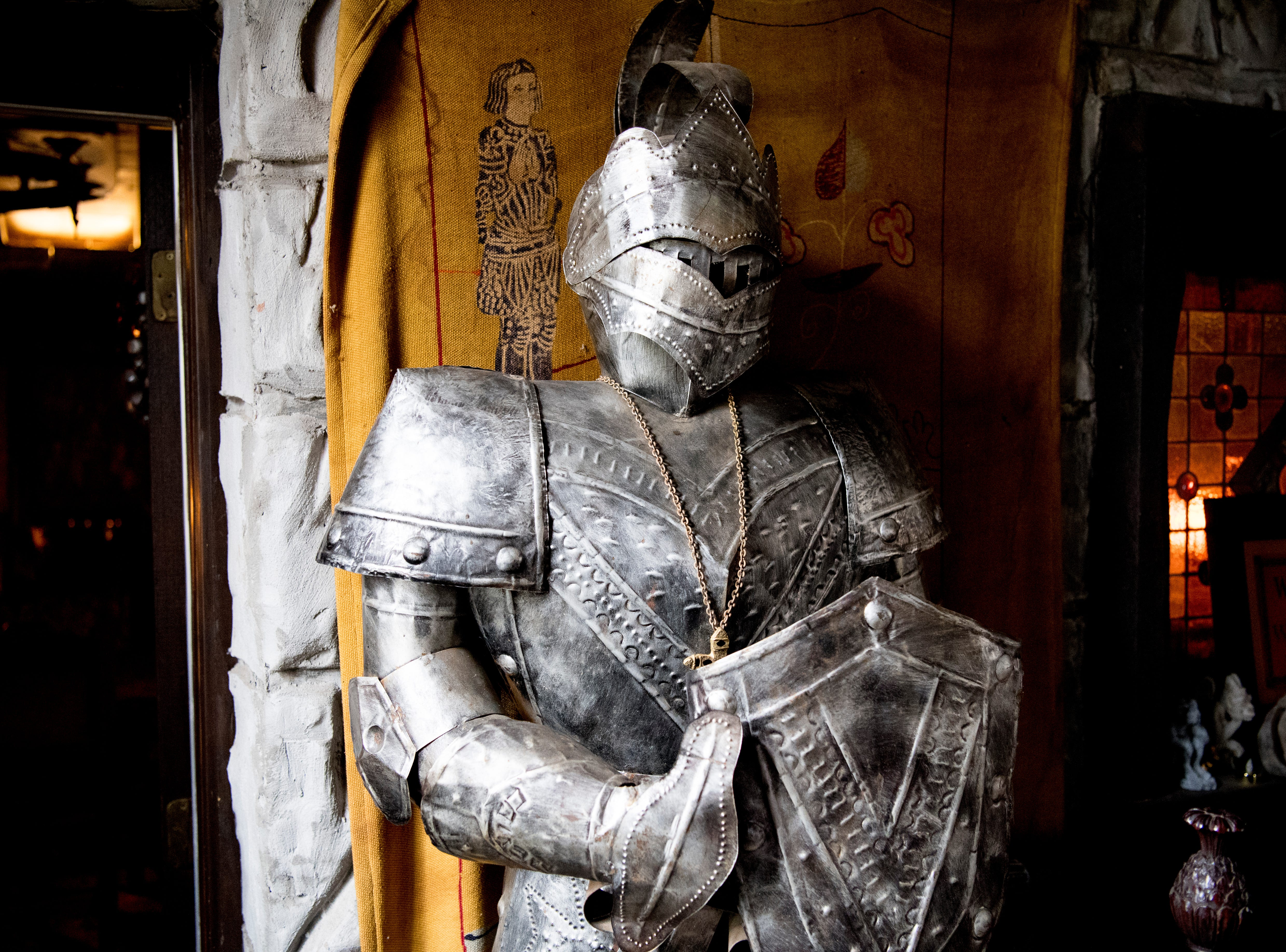 Visitors are greeted by a suit of knight's armor in the main entrance inside Williamswood Castle in South Knoxville, Tennessee on Thursday, January 17, 2019. The home, modeled after a medieval castle, was built by Julia Tucker in 1991 and took 6 years to complete. Many of the items in the home were sourced from around the Knoxville area.