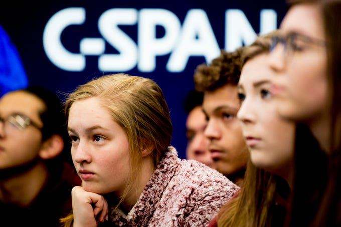 Fulton High School sophomore Cassie Vaughn listens to a presentation inside the C-SPAN Bus during a tour stop at Fulton High School in Knoxville, Tennessee on Thursday, January 17, 2019. The bus tour, which is in its 25th year, has been to over 8,000 events and has hosted 1.5 million visitors including 40,000 teachers and 800,000 students since 1993 teaching about their coverage of the political process.