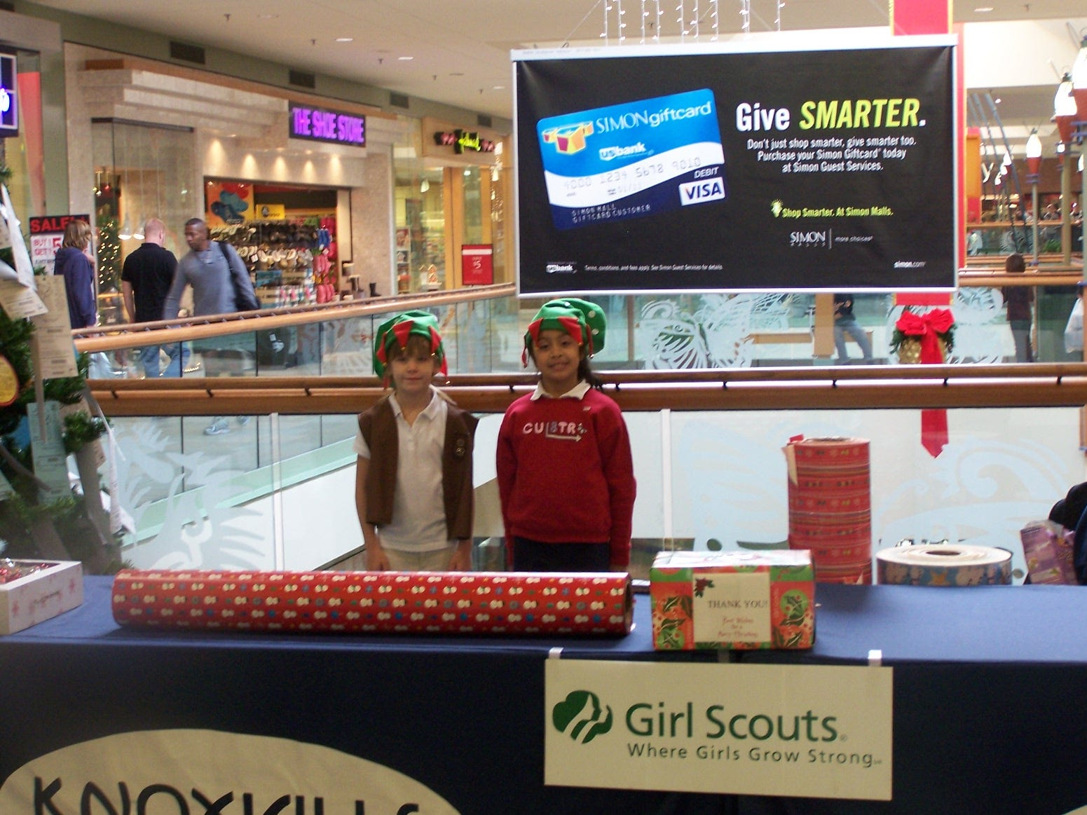 Girl Scout Troop 605 and 680 make shopping easier this holiday season by providing free gift wrapping at the Knoxville Center mall. Kessie Copeland, left, and Yanelie Vasquez are Santa's little helpers.