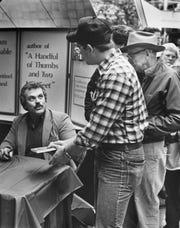 News Sentinel columnist Sam Venable autographs books on Nov. 10, 1985, at East Towne Mall. Venable retired Sept. 5, 2014.