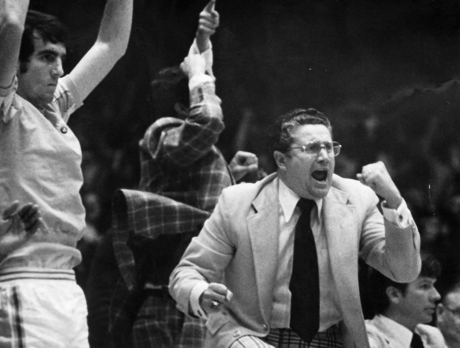 University of Tennessee basketball Coach Ray Mears gets excited during a game in 1974 at Stokely Athletic Center. (News Sentinel Archive)