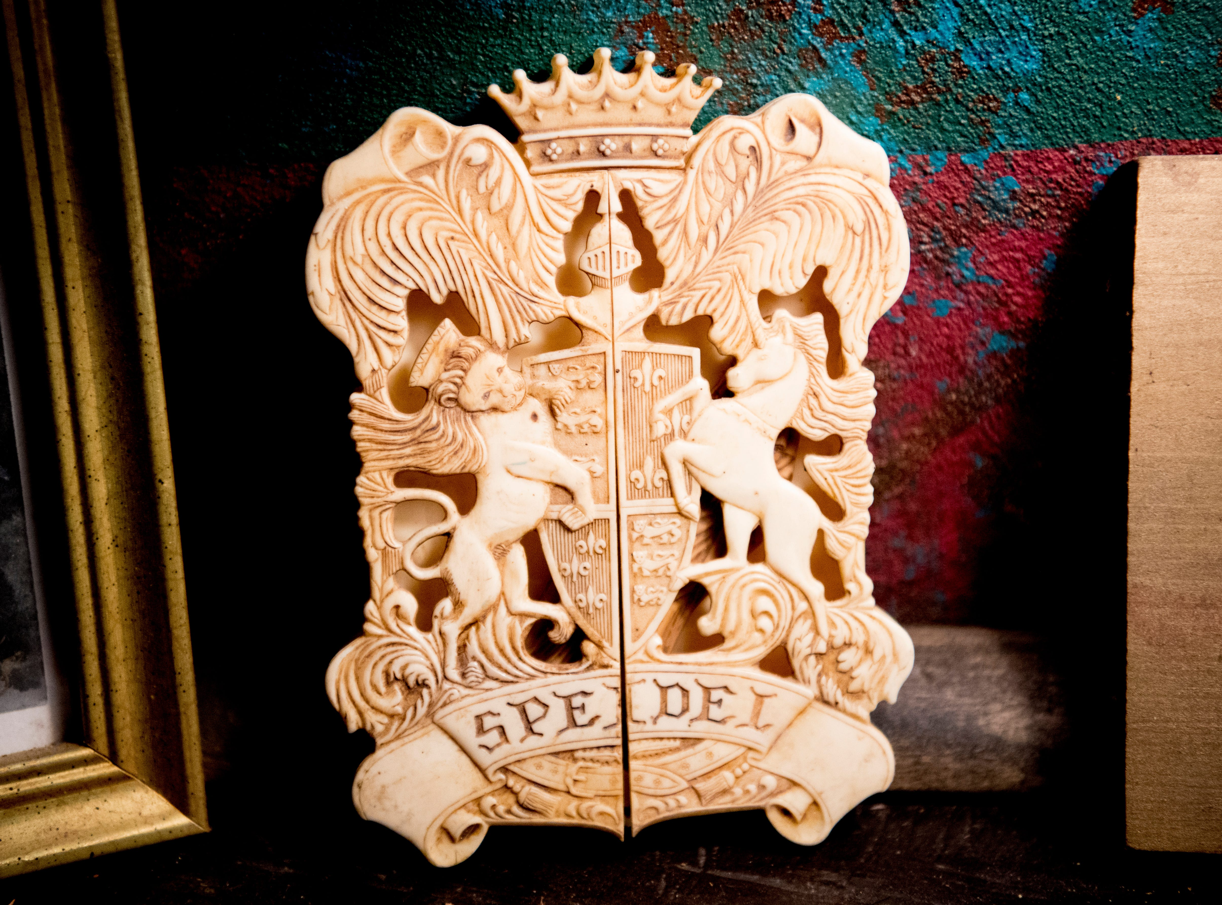 A Speidel family coat of arms inside Williamswood Castle in South Knoxville, Tennessee on Thursday, January 17, 2019. The home, modeled after a Scottish castle, was built by Julia Tucker in 1991 and took 6 years to complete. Many of the items in the home were sourced from around the Knoxville area.