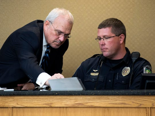 Knox County Public Defender Mark Stephens, left, points out an item in a photo for KPD Officer Tim Edwards, right, during a preliminary hearing for Francisco Eduardo Franco-Cambrany in Knox County General Sessions Court on Thursday, January 17, 2019.