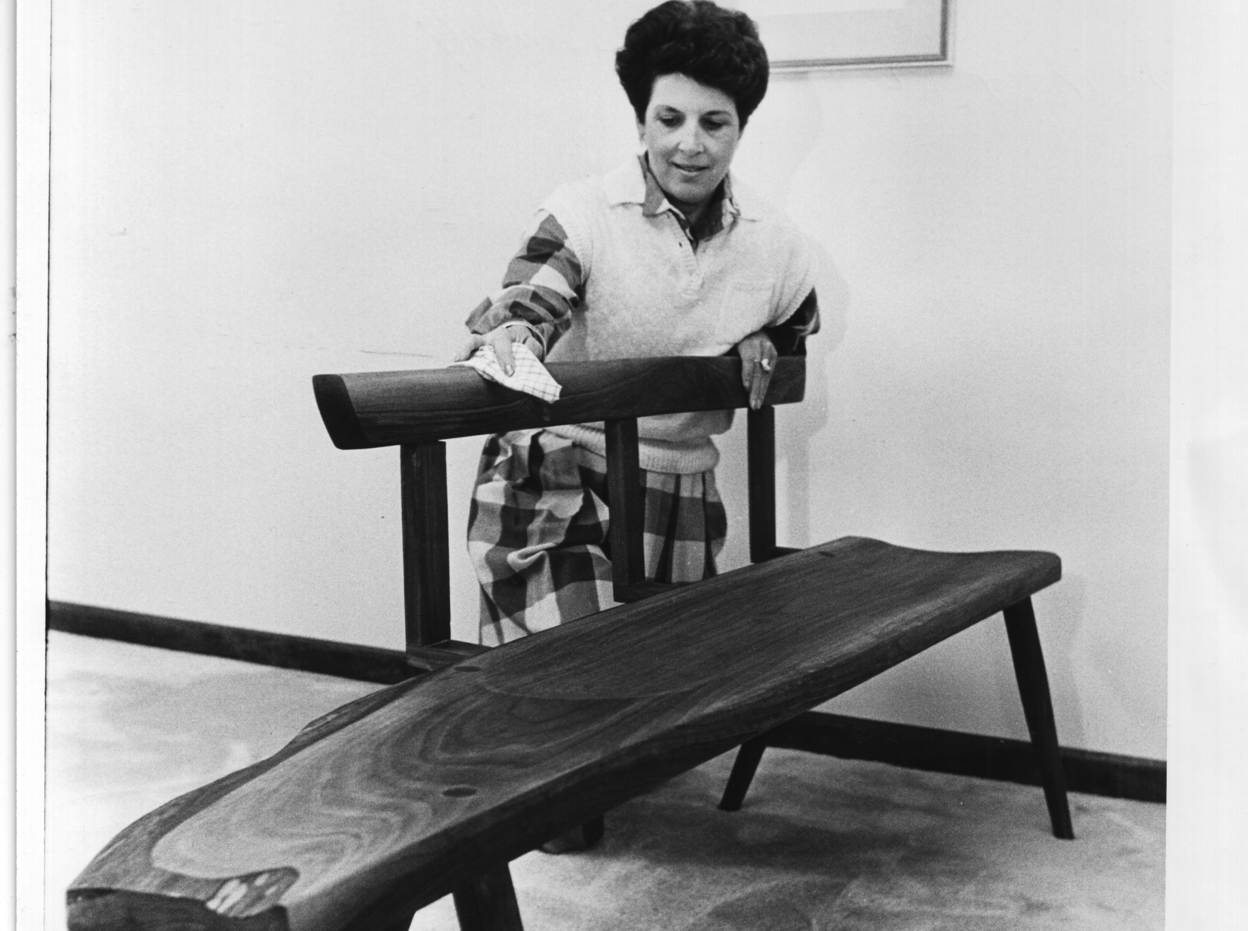 Ann Julius polishes a bench made by former President Jimmy Carter April 16, 1986 during the Dogwood Arts Festival. The bench was displayed at the Master Cabinet Makers show at East Towne Mall. Julius was co-chair of the previous year's Dogwood Arts Festival.