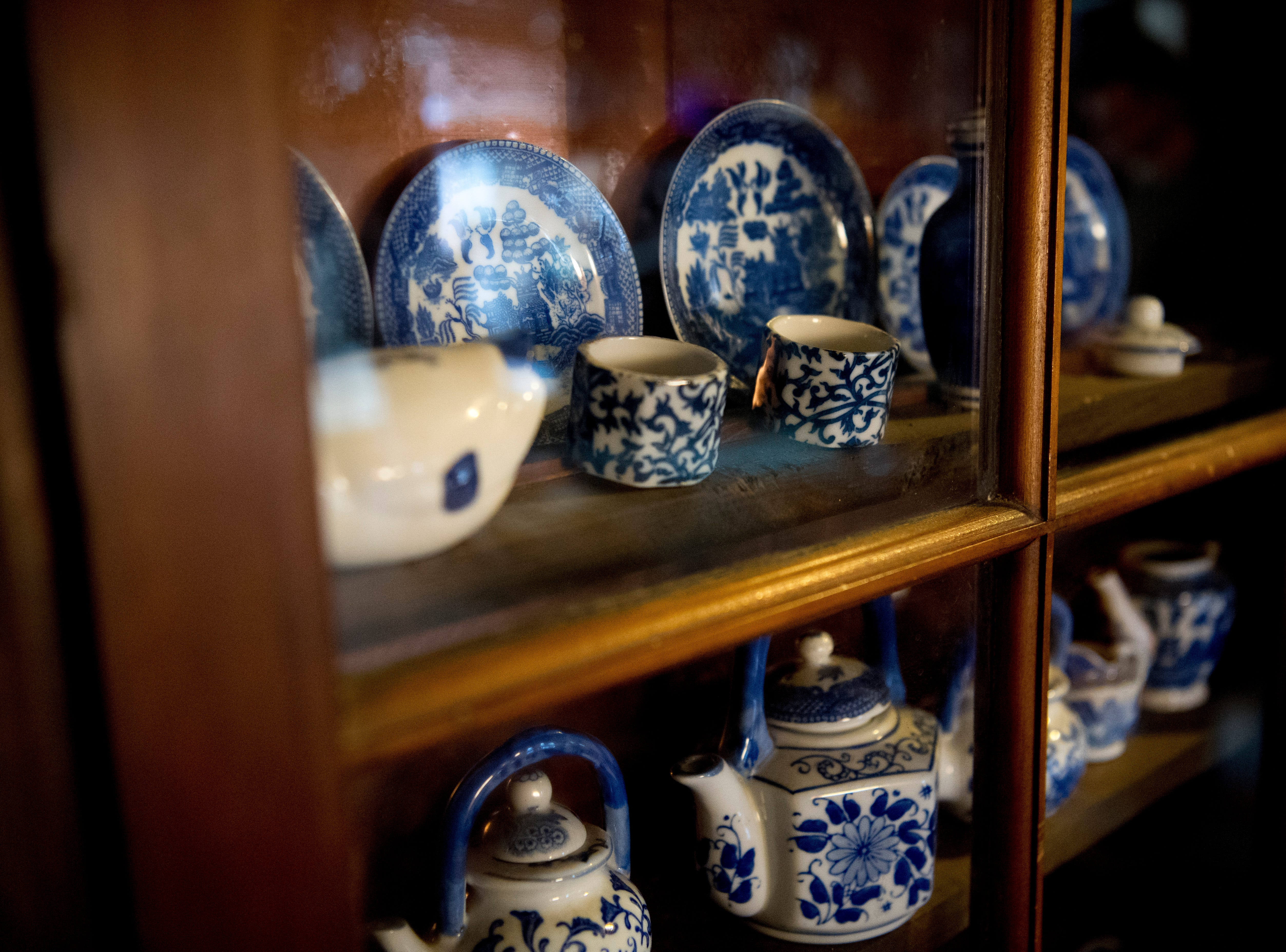 Vintage china sits in a cabinet inside Williamswood Castle in South Knoxville, Tennessee on Thursday, January 17, 2019. The home, modeled after a medieval castle, was built by Julia Tucker in 1991 and took 6 years to complete. Many of the items in the home were sourced from around the Knoxville area.