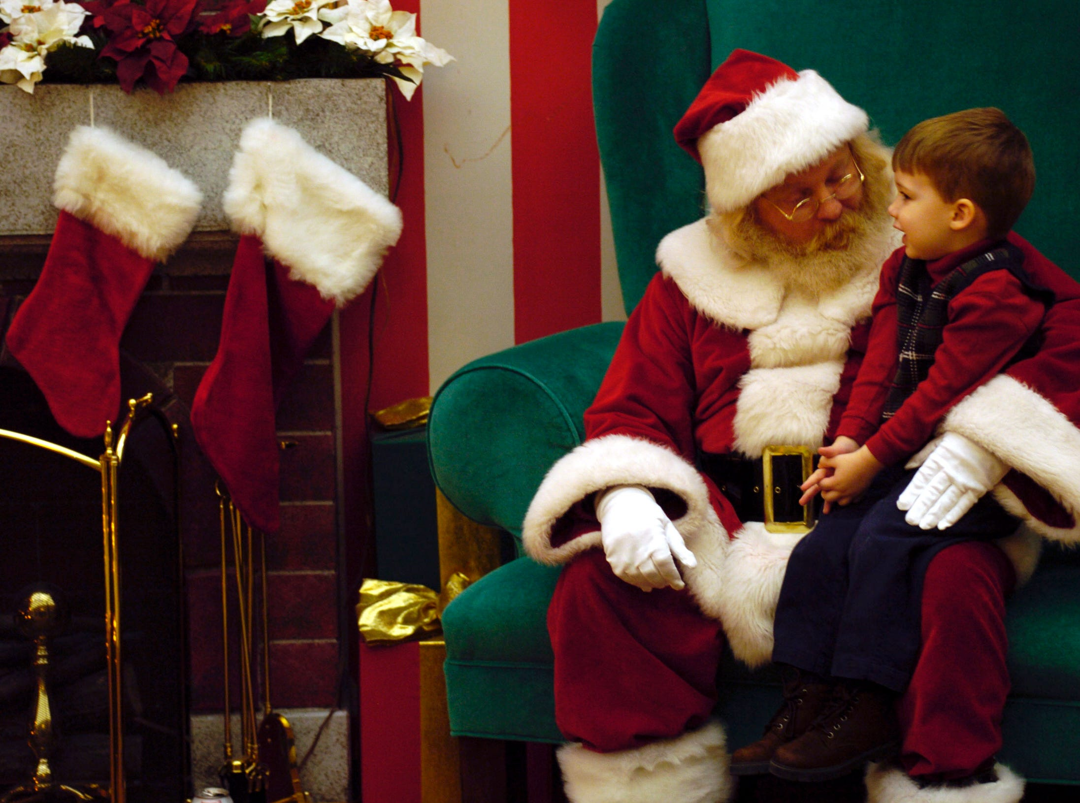 Santa Claus at the Knoxville Center Mall takes Christmas wishes from three year-old Grant Pettis. 12/11/2004