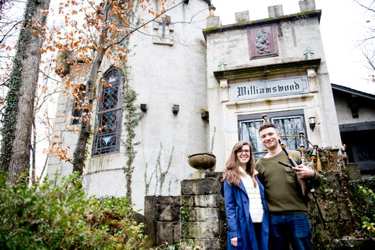 Siblings Julia and Tyler Roy pose for a photo in front of their family's Williamswood Castle in South Knoxville, Tennessee on January 17, 2019. The home, modeled after a medieval castle, was built by Julia Tucker beginning in 1991 and took six years to complete. Many of the items in the home were sourced from around the Knoxville area.
