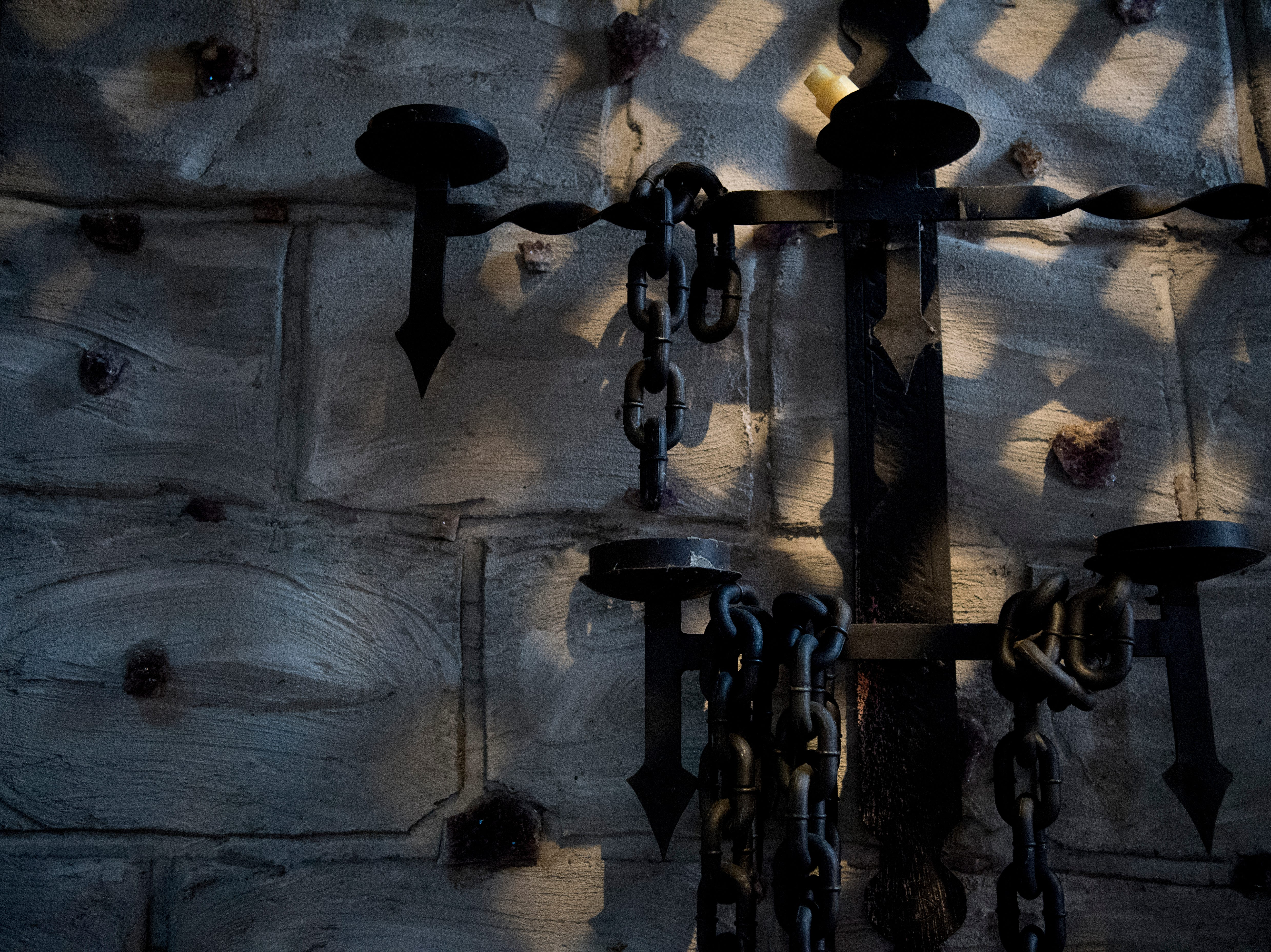 Chains hang from the wall in the dungeon inside Williamswood Castle in South Knoxville, Tennessee on Thursday, January 17, 2019. The home, modeled after a medieval castle, was built by Julia Tucker in 1991 and took 6 years to complete. Many of the items in the home were sourced from around the Knoxville area.