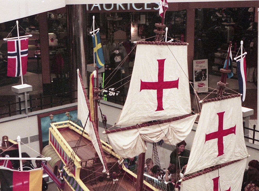 Ruel Shouppe explains about the 1/15th scale replica of a 17th century Spanish Galleon to school children at East Towne Mall, November, 1996.