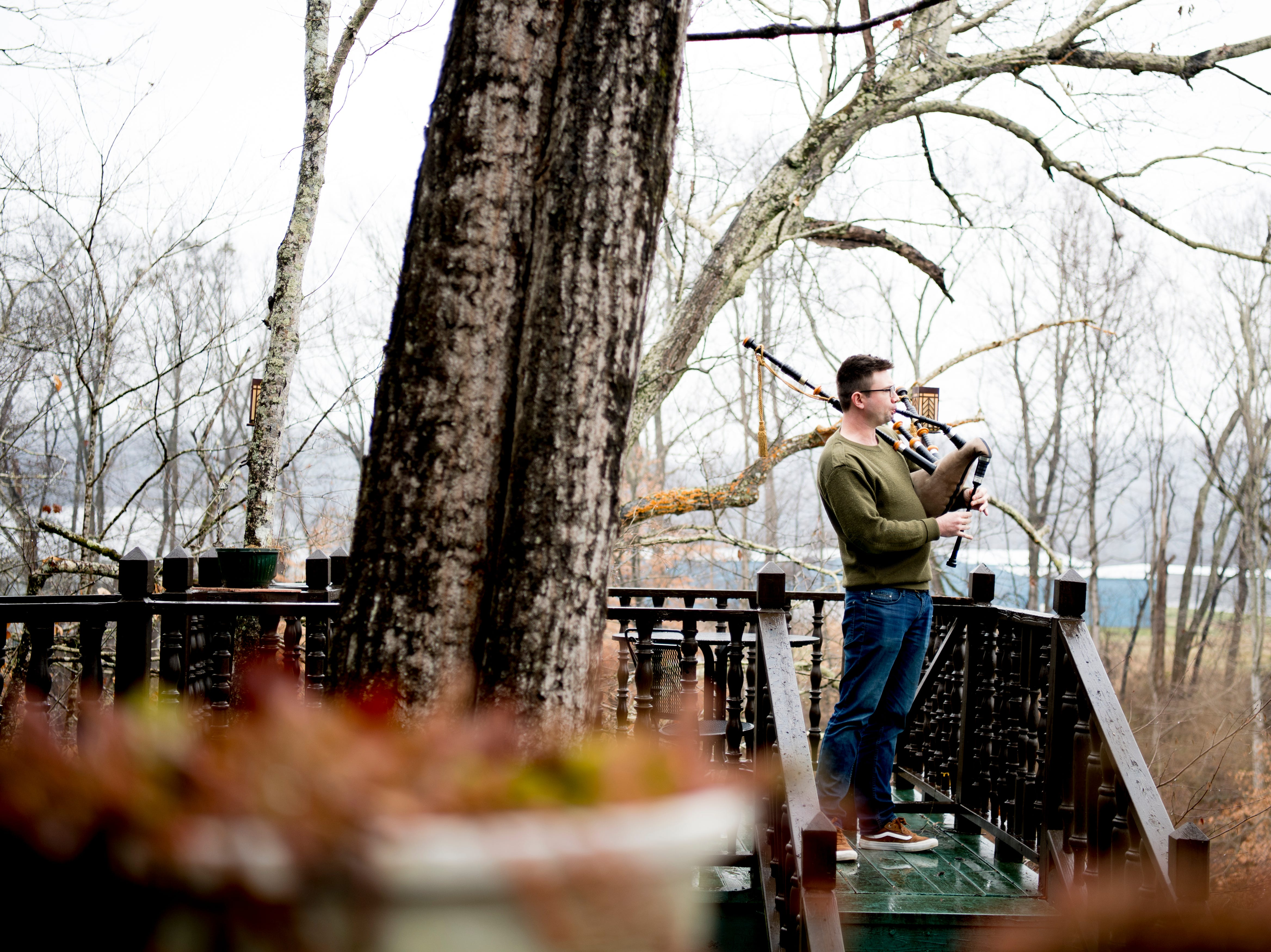 Tyler Roy practices his bagpipe on the back porch of Williamswood Castle in South Knoxville, Tennessee on Thursday, January 17, 2019. The home, modeled after a medieval castle, was built by Julia Tucker in 1991 and took 6 years to complete. Many of the items in the home were sourced from around the Knoxville area.