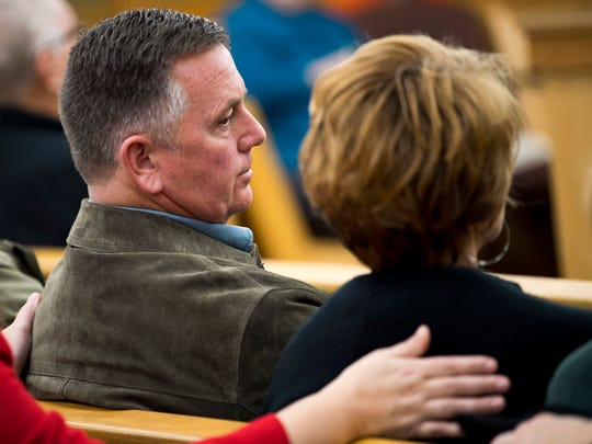 Knoxville Fire Capt. D.J. Corcoran, left, and his wife Wendy Corcoran, right, during a preliminary hearing for Francisco Eduardo Franco-Cambrany in Knox County General Sessions Court on Thursday, January 17, 2019.