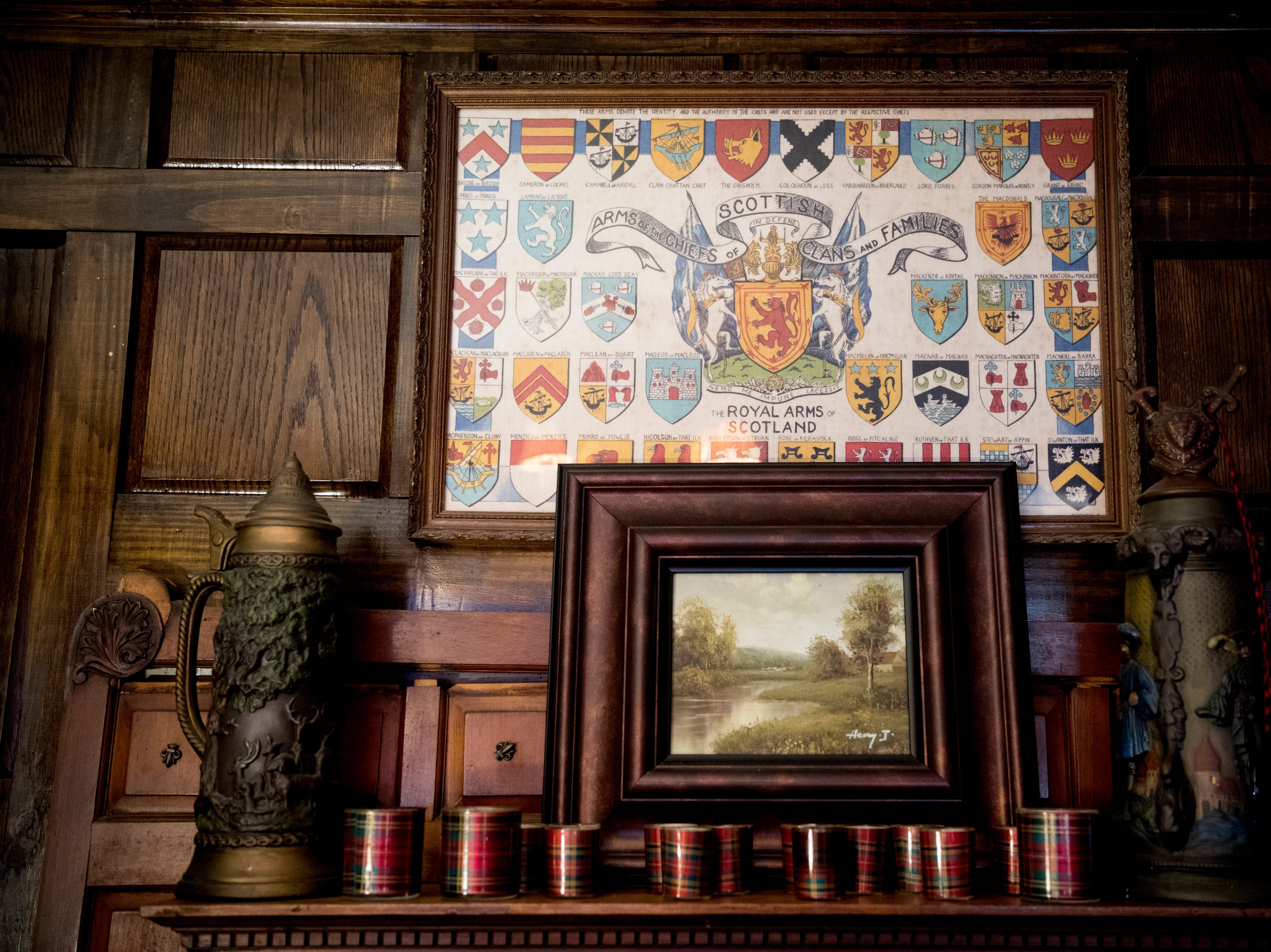 A poster of Scottish coats of arms sits on a mantel inside Williamswood Castle in South Knoxville, Tennessee on Thursday, January 17, 2019. The home, modeled after a medieval castle, was built by Julia Tucker in 1991 and took 6 years to complete. Many of the items in the home were sourced from around the Knoxville area.