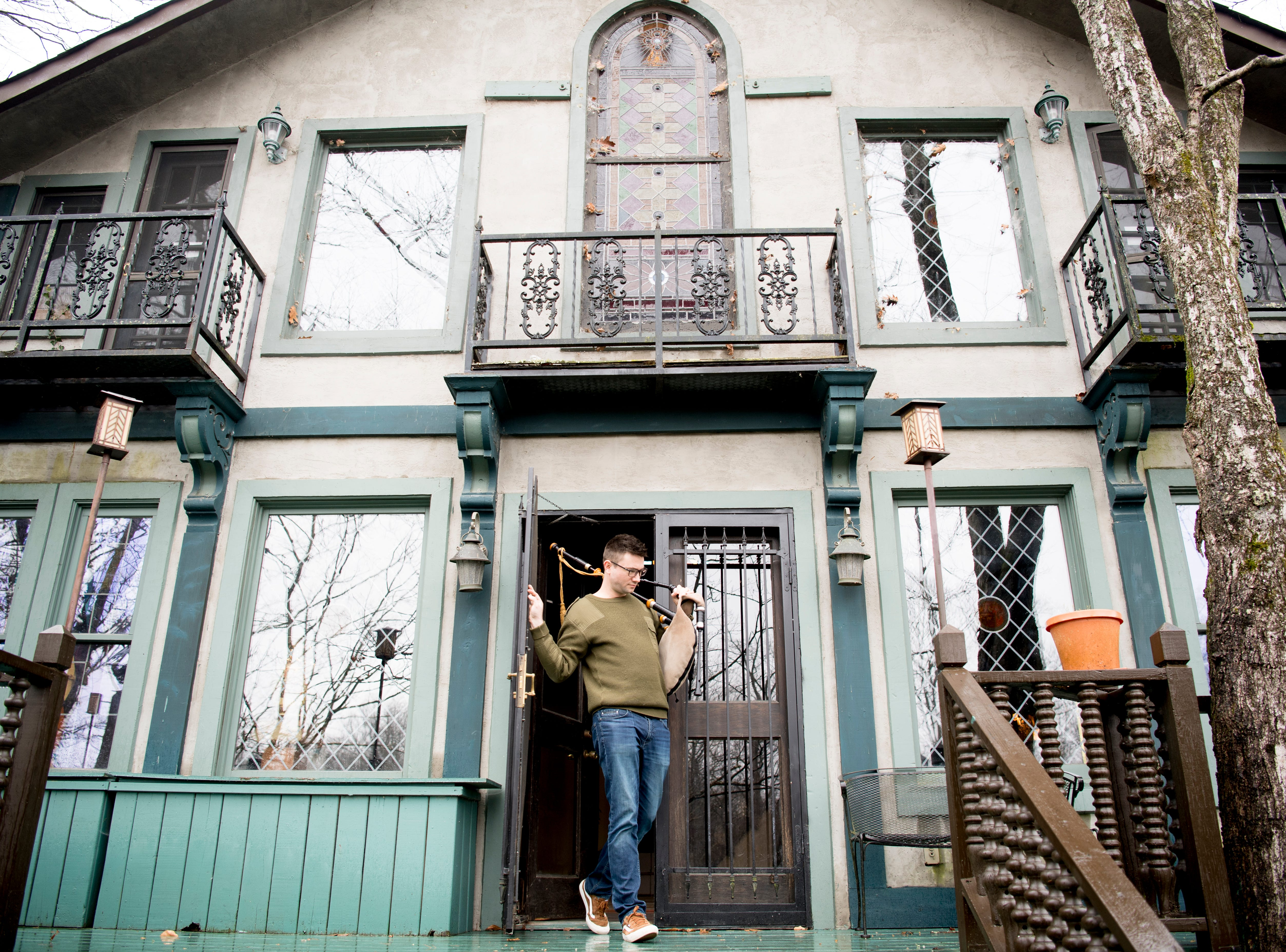 Tyler Roy walks out onto the back porch of Williamswood Castle in South Knoxville, Tennessee on Thursday, Jan. 17, 2019. The home, modeled after a medieval castle, was built by his grandmother Julia Tucker beginning in 1991 and took six years to complete. Many of the items in the home were sourced from around the Knoxville area. In 2019, the castle was listed on Airbnb.