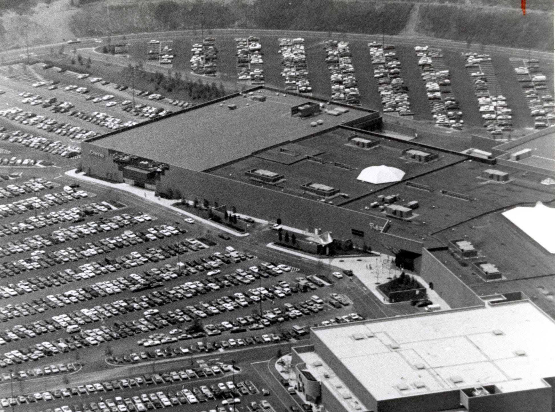 An aerial shot of the East Towne Mall parking lot, July, 1984.