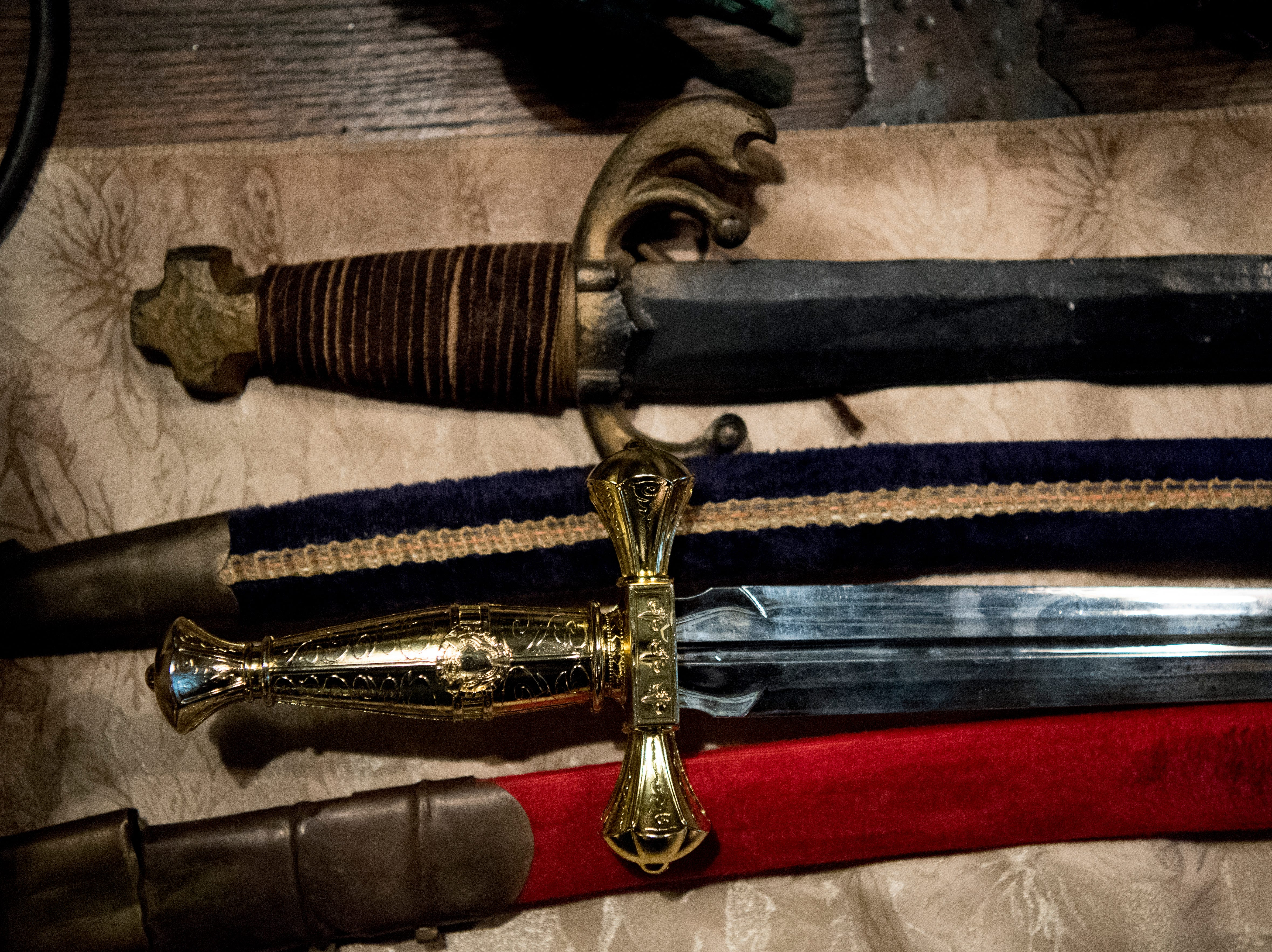 Swords sit on a table inside Williamswood Castle in South Knoxville, Tennessee on Thursday, January 17, 2019. The home, modeled after a medieval castle, was built by Julia Tucker in 1991 and took 6 years to complete. Many of the items in the home were sourced from around the Knoxville area.