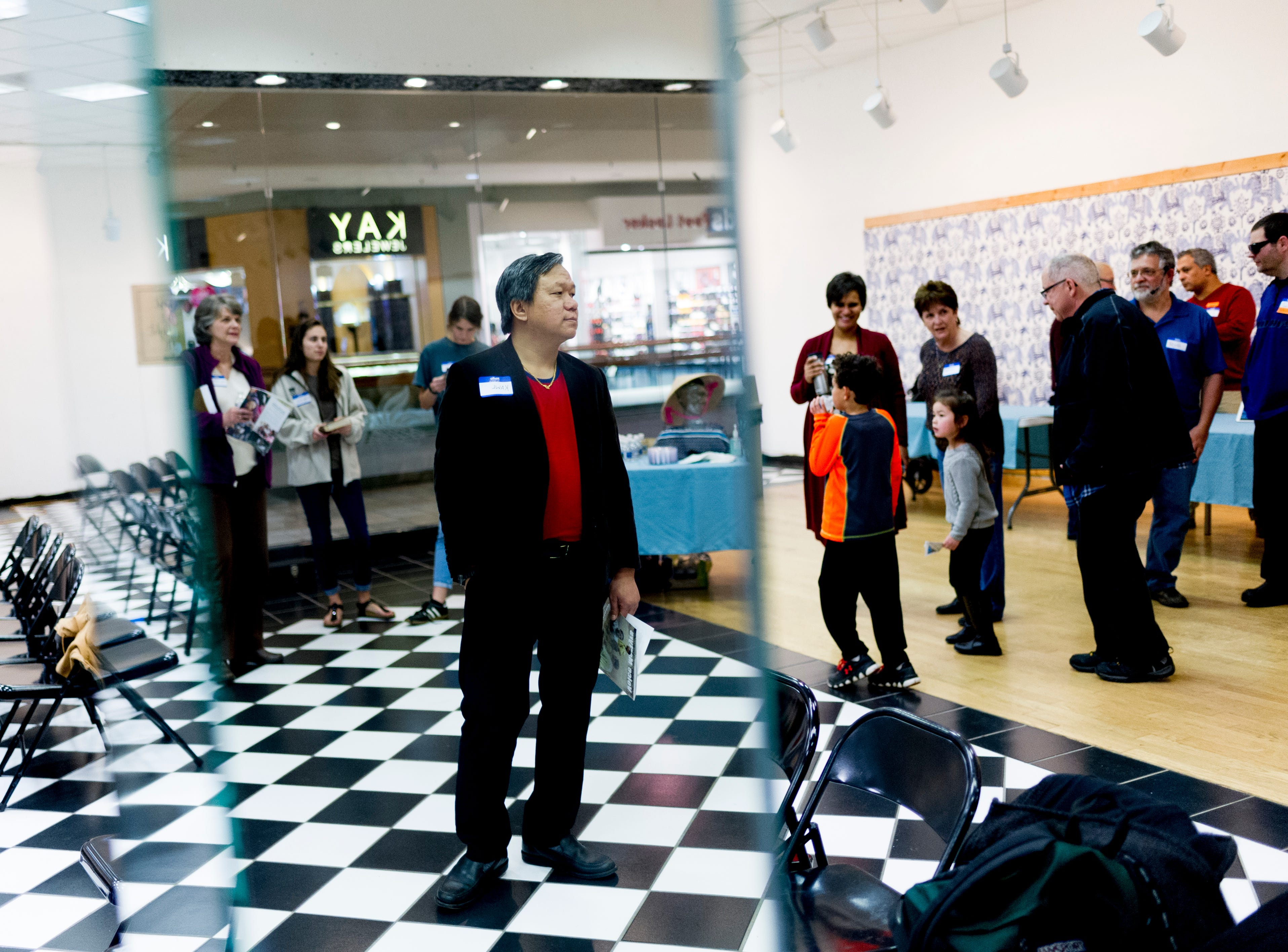 Attendees arrive during the monthly Gathering of Nations worship service at East Town Mall in Knoxville, Tennessee on Friday, February 9, 2018. Christians from a variety of nations meet once a month for a service where they pray, sing and worhsip in their respective native tongues.