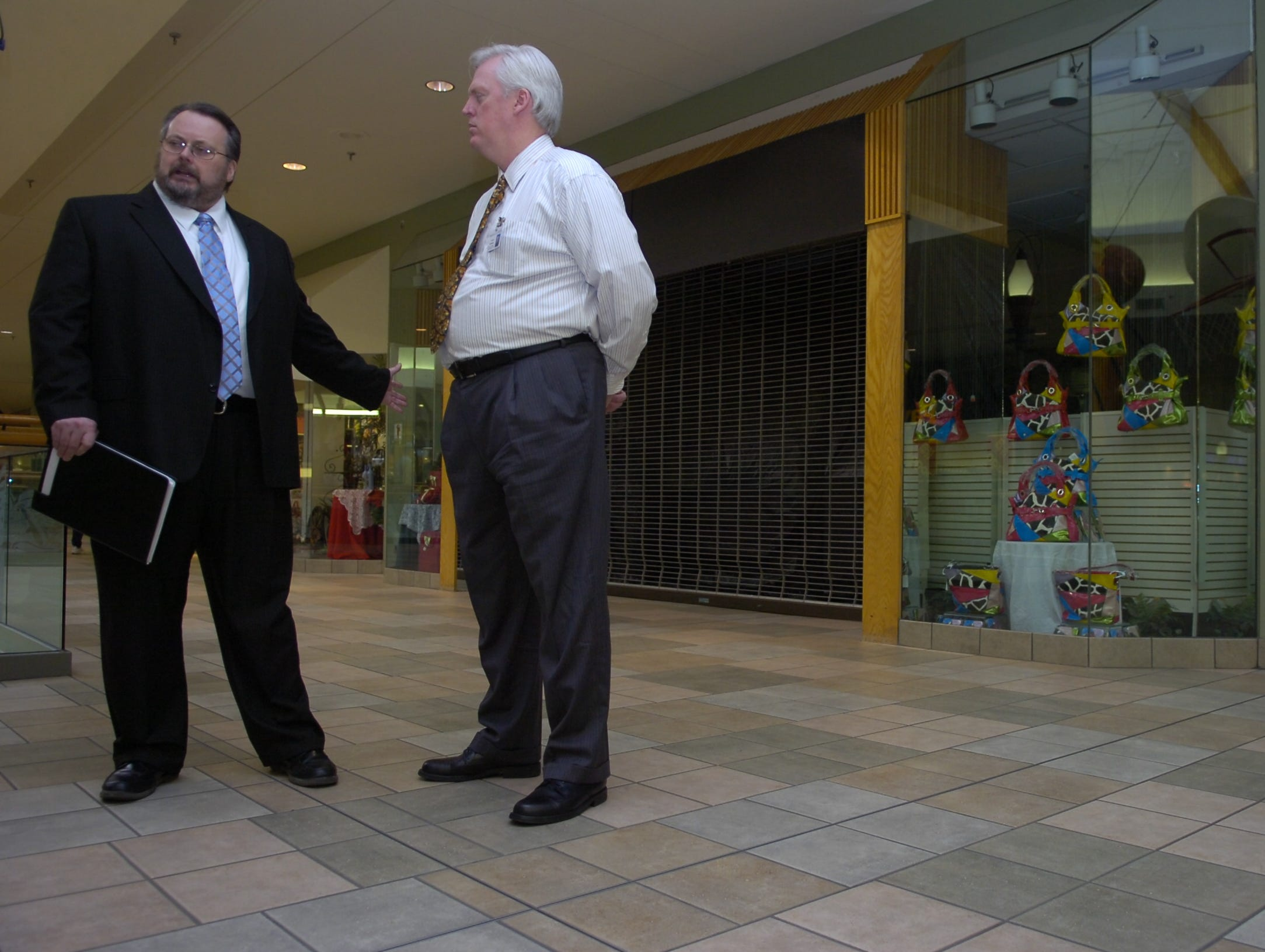 Don Lawson, left, Director of Career, Technical, and Adult Education for Knox County Schools talks with Tim Hill, Area Manager for West Town and Knoxville Center Malls, Friday, Jan. 22, 2010 at Knoxville Center Mall. A 6,400 square-foot space at Knoxville Center Mall is proposed for a new school to give roughly 280 Knox County students an alternative education option.