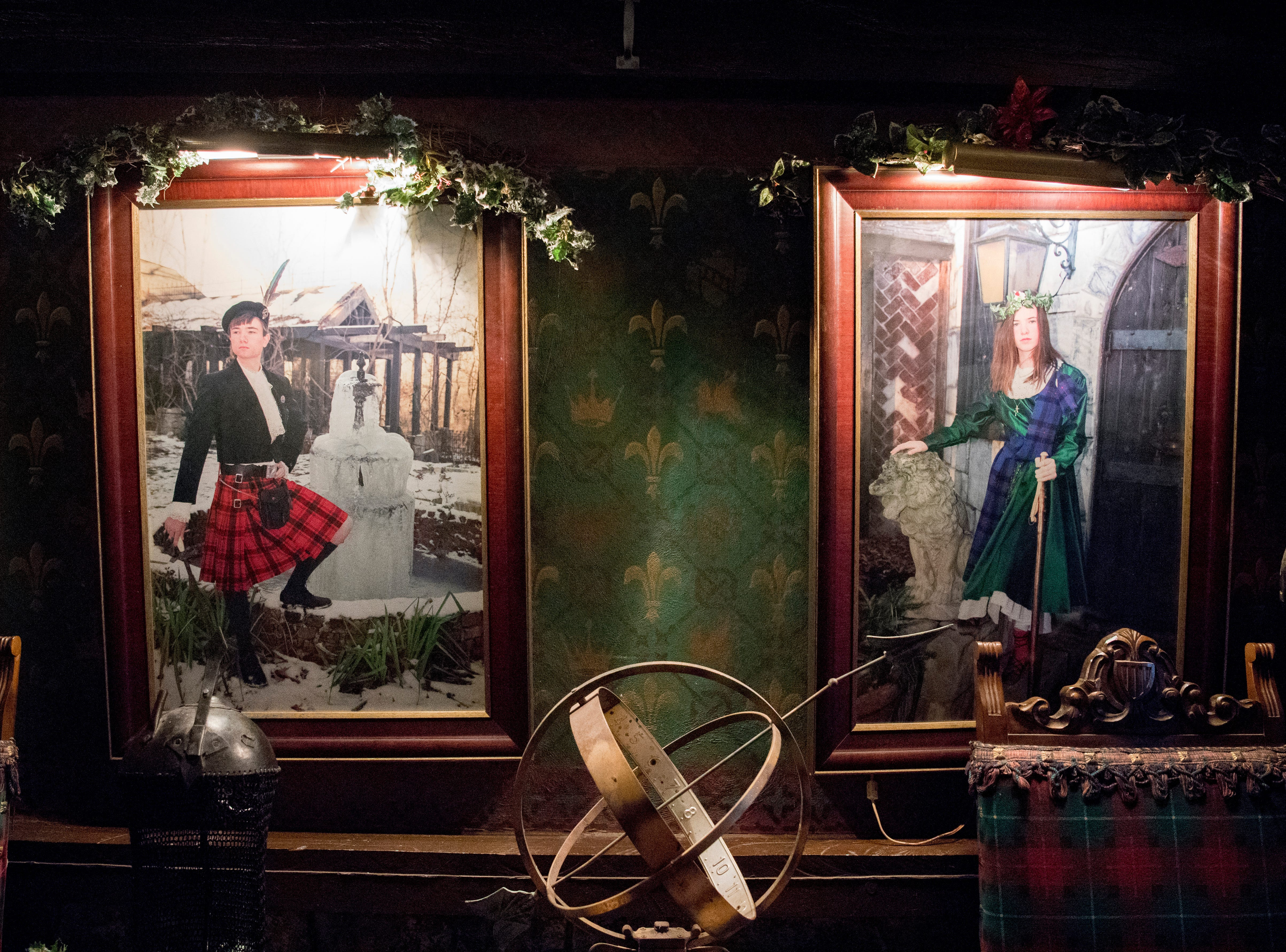 Painted portraits of Tyler and Julia Roy in the main hall inside Williamswood Castle in South Knoxville, Tennessee. The home, modeled after a medieval castle, was built by their grandmother Julia Tucker beginning in 1991 and took six years to complete. Many of the items in the home were sourced from around the Knoxville area. In 2019, the castle was listed on Airbnb.