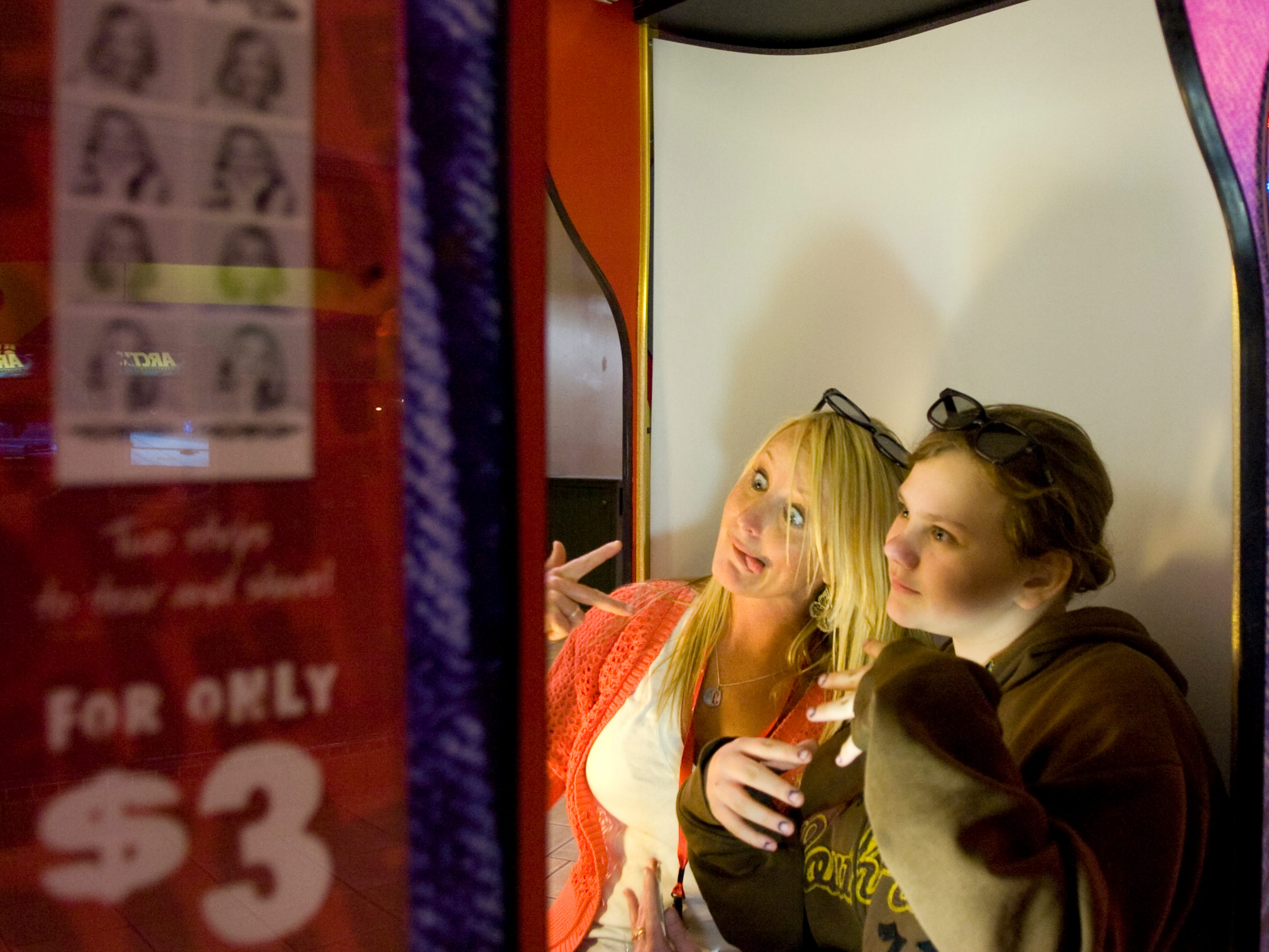 Christi Hampton, left, and Judy Ridenour, 11, pose for photographs inside a photo booth at Knoxville Center mall on Wednesday, Mar. 10, 2010.