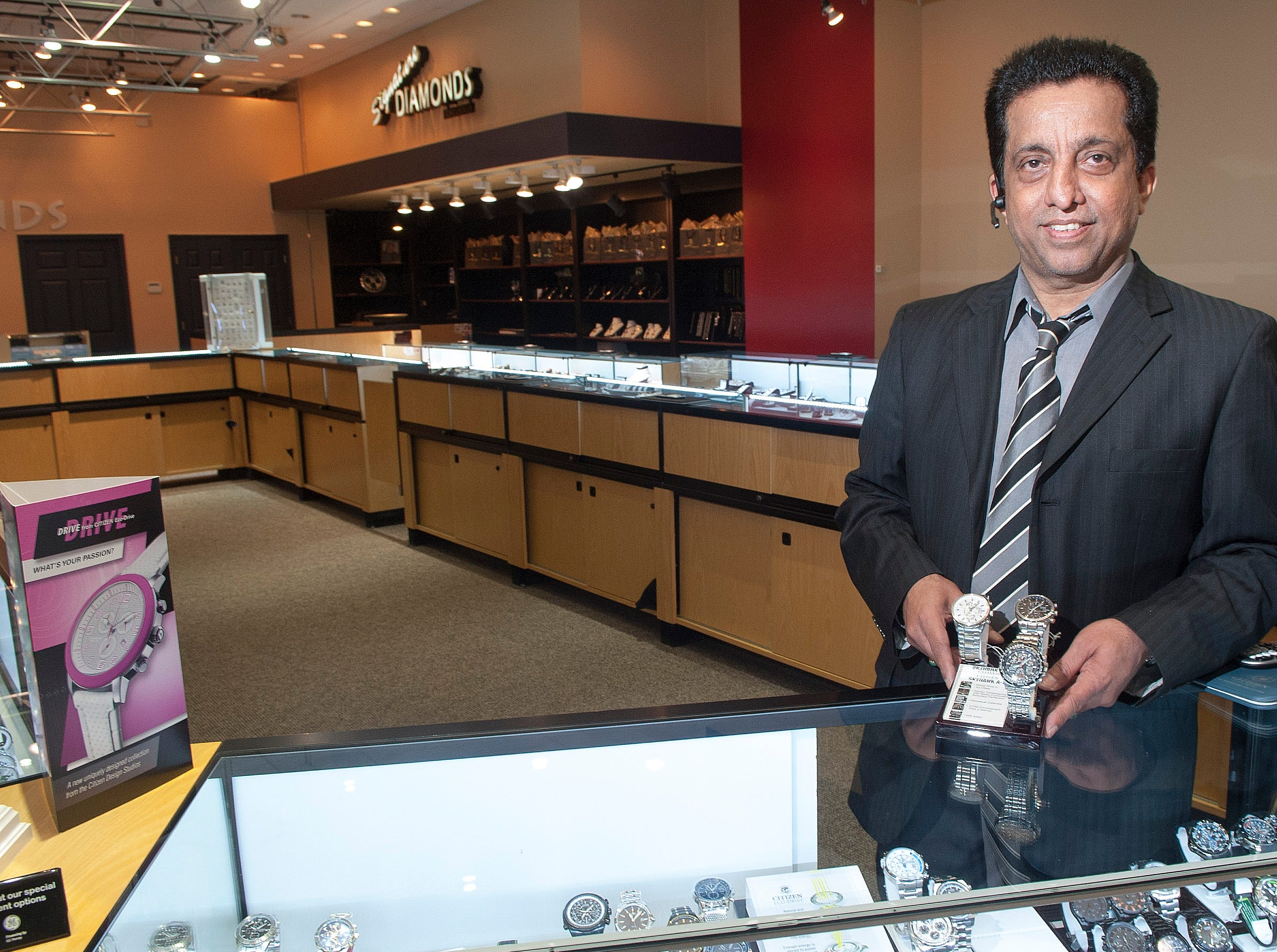 """""""Ike"""" Amyn Lalani recently expanded his store Signature Diamonds Galleria into a larger space at the Knoxville Center Mall.  The store offers Watches Custom Jewelry and repairs on site.An effort is underway to rejuvenate Knoxville Center Mall and the surrounding area including new signage, vegetation management and new business organization. The mall has suffered over the years from a loss of businesses and shoppers and Simon Properties had the property on the market for sale last year. ( J. MILES CARY/NEWS SENTINEL )"""