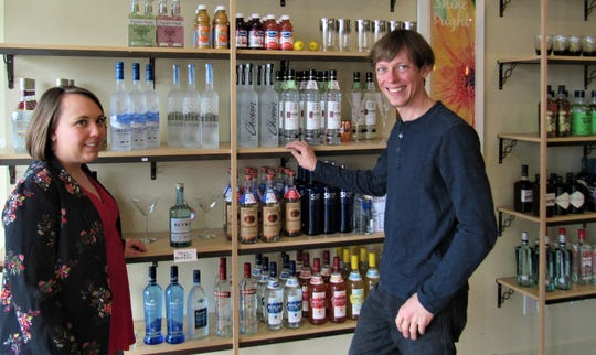 Owners Haley Krotz and Kyle Zellner show off an extensive selection of vodka. If they don't have your favorite they can get it.