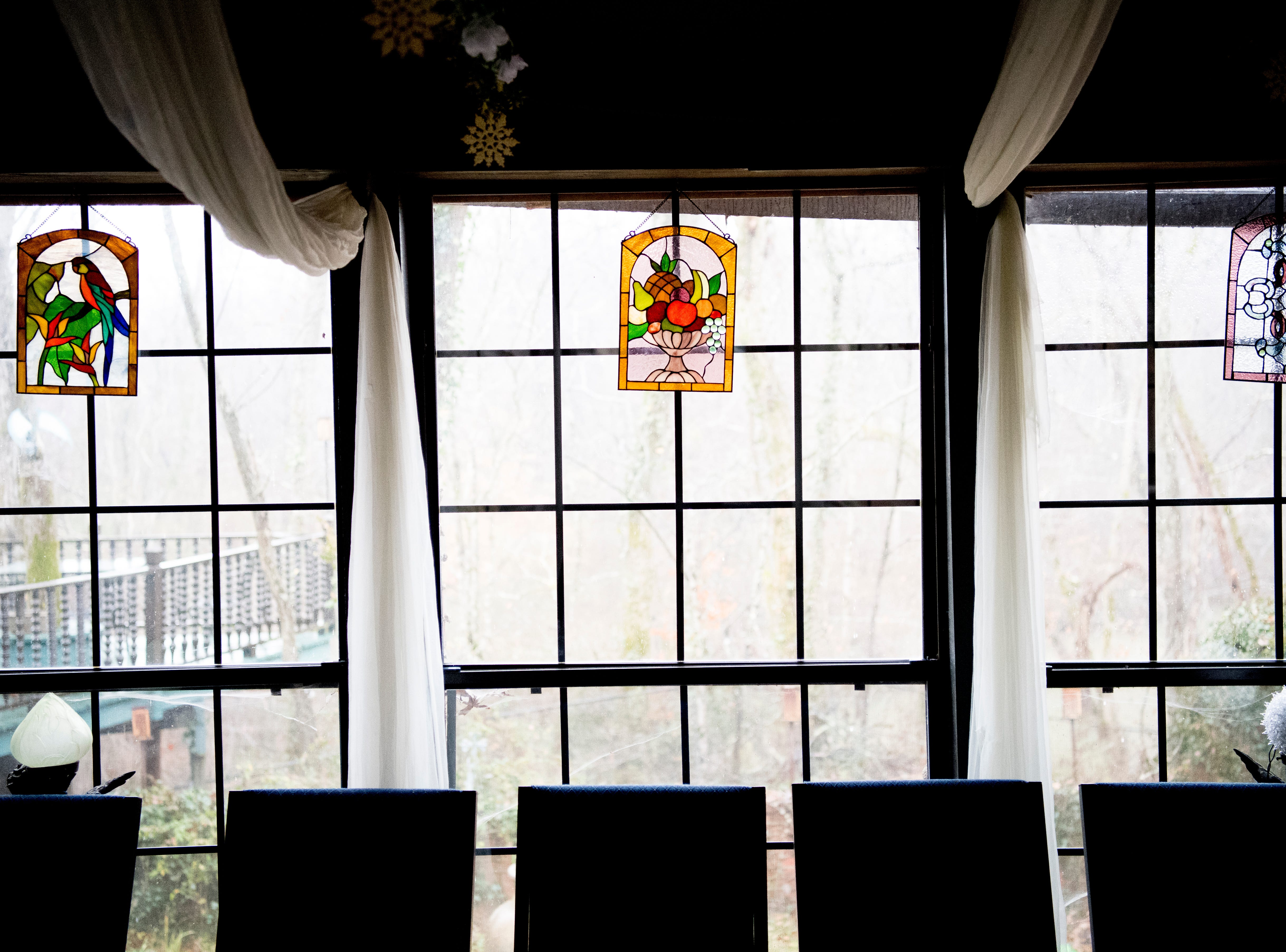 Stained glass decorations in the solarium inside Williamswood Castle in South Knoxville, Tennessee on Thursday, January 17, 2019. The home, modeled after a Scottish castle, was built by Julia Tucker in 1991 and took 6 years to complete. Many of the items in the home were sourced from around the Knoxville area.