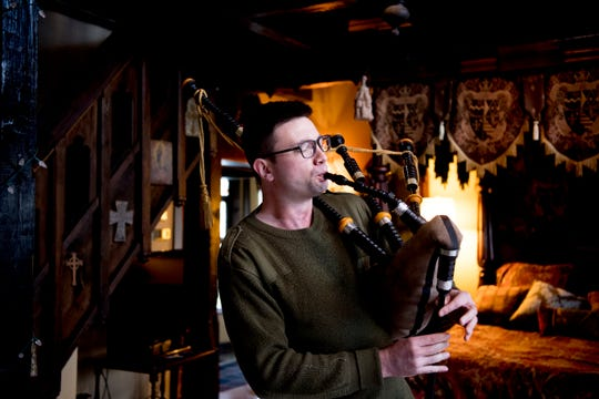 Tyler Roy plays his bagpipe in the master bedroom inside Williamswood Castle in South Knoxville, Tennessee on Thursday, January 17, 2019. The home, modeled after a medieval castle, was built by Julia Tucker in 1991 and took 6 years to complete. Many of the items in the home were sourced from around the Knoxville area.