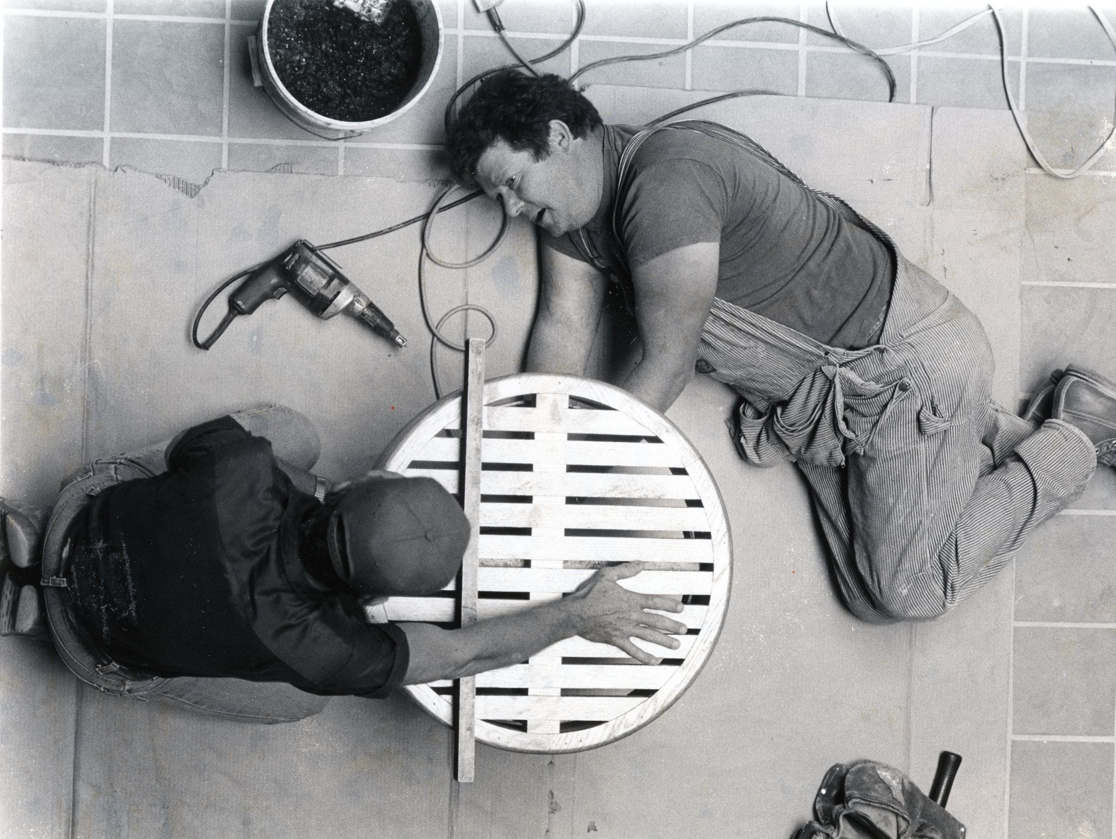 Wayne Tipton, left, and Rex Watson, with Rentenbach Engineering work inside East Towne Mall, June, 1984.