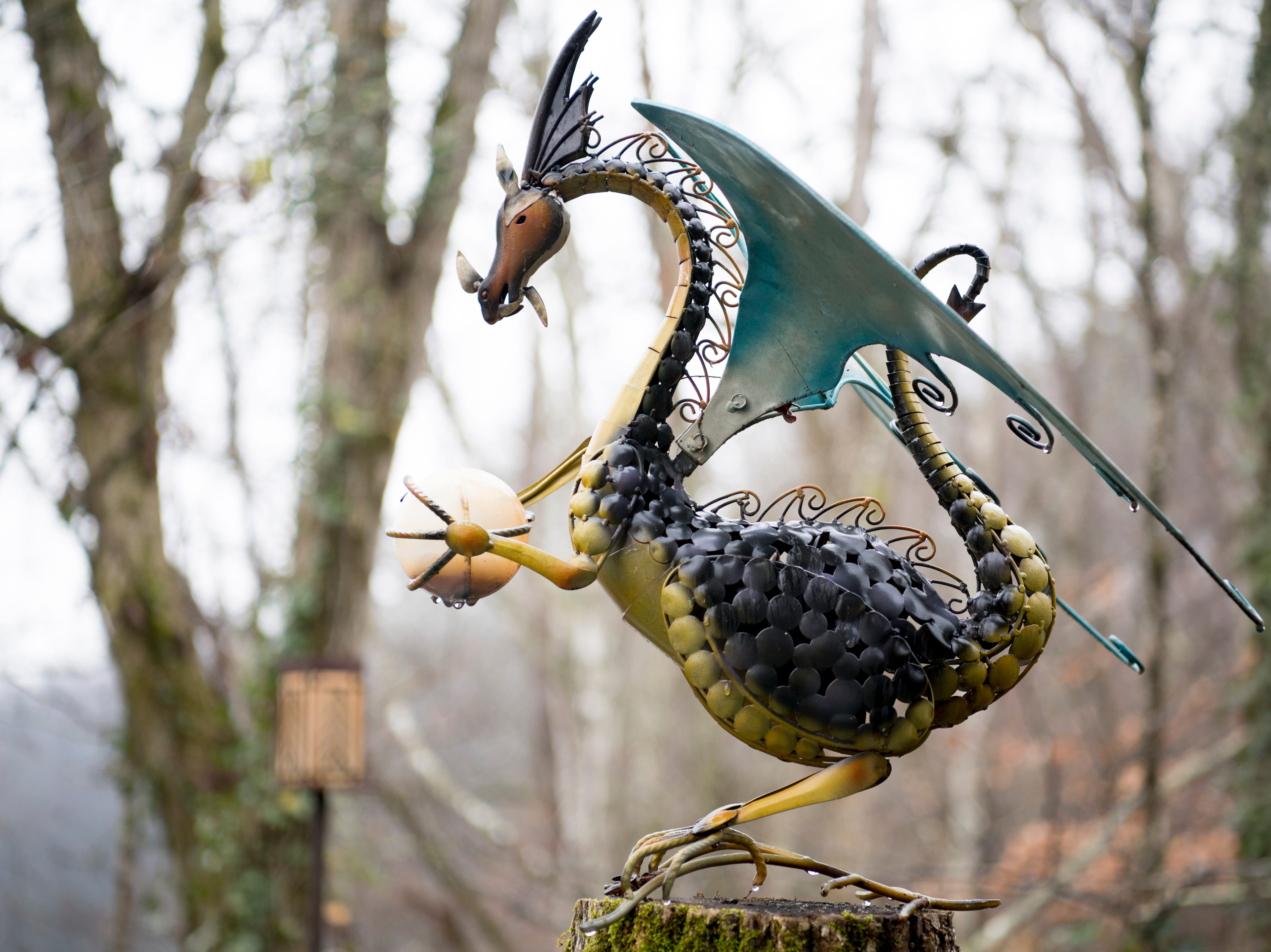 A dragon sculpture on the back porch of Williamswood Castle in South Knoxville, Tennessee on Thursday, January 17, 2019. The home, modeled after a medieval castle, was built by Julia Tucker in 1991 and took 6 years to complete. Many of the items in the home were sourced from around the Knoxville area.