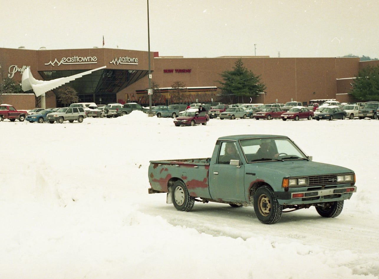 Much of the parking lot of East Towne Mall remained covered with snow instead of cars, February, 1996.