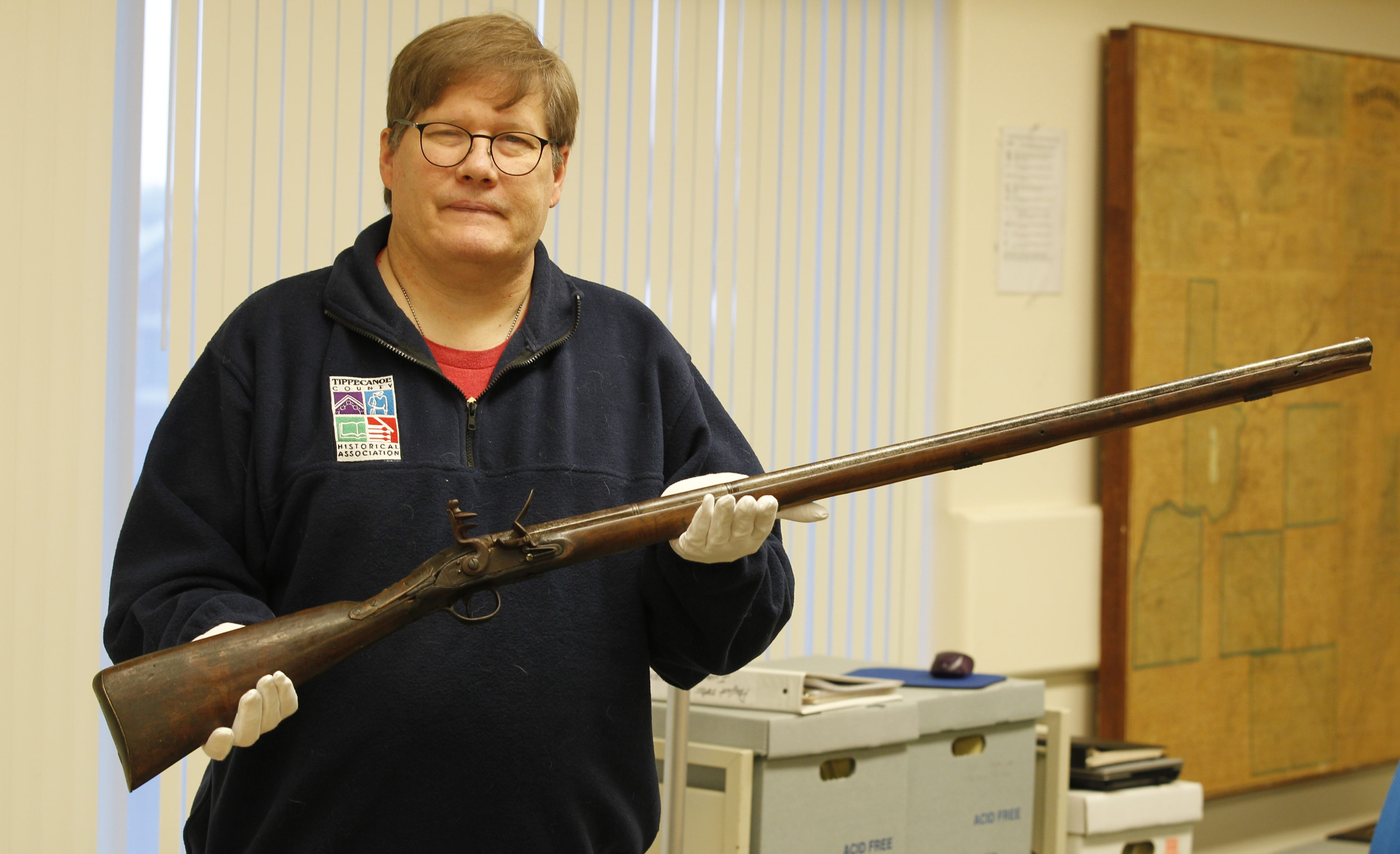 Tippecanoe County Historical Association Executive Director Craig Hadley holds a British trade musket that the association recently received from donors Michael and Amy Molter of Lafayette. The British supplied these weapons to Native Americans before and during the War of 1812 as a way to incite violence on American settlers and soldiers. This particular musket is the type of firearm the Indians used at the Battle of Tippecanoe in November 1811, although there is no way of knowing whether this piece was at that battle.