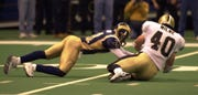 St. Louis Rams kick returner Az-Zahir Hakim (81) drops a punt return late in the fourth quarter, as New Orleans Saints' Brian Milne (40) recovers the fumble during their NFC Wildcard playoff game at the Louisiana Superdome in New Orleans on Dec. 30, 2000.