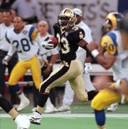 Saints kick return specialist Tyrone Hughes (33) races to the end zone against the Los Angeles Rams on Oct. 23, 1994, in the Louisiana Superdome in New Orleans. Hughes returned the kickoff for a touchdown.