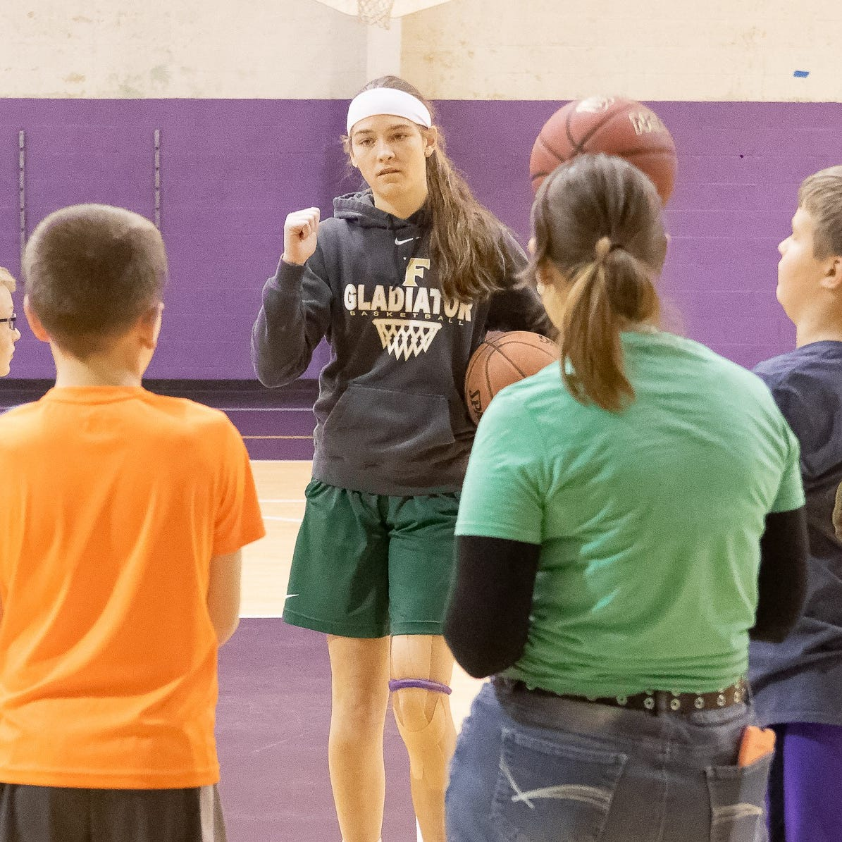 Fowlerville basketball star enjoying role as sixth-grade coach