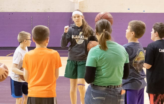 Fowlerville senior Elie Smith coaches a sixth-grade boys basketball team that has won three straight games after an 0-2 start.