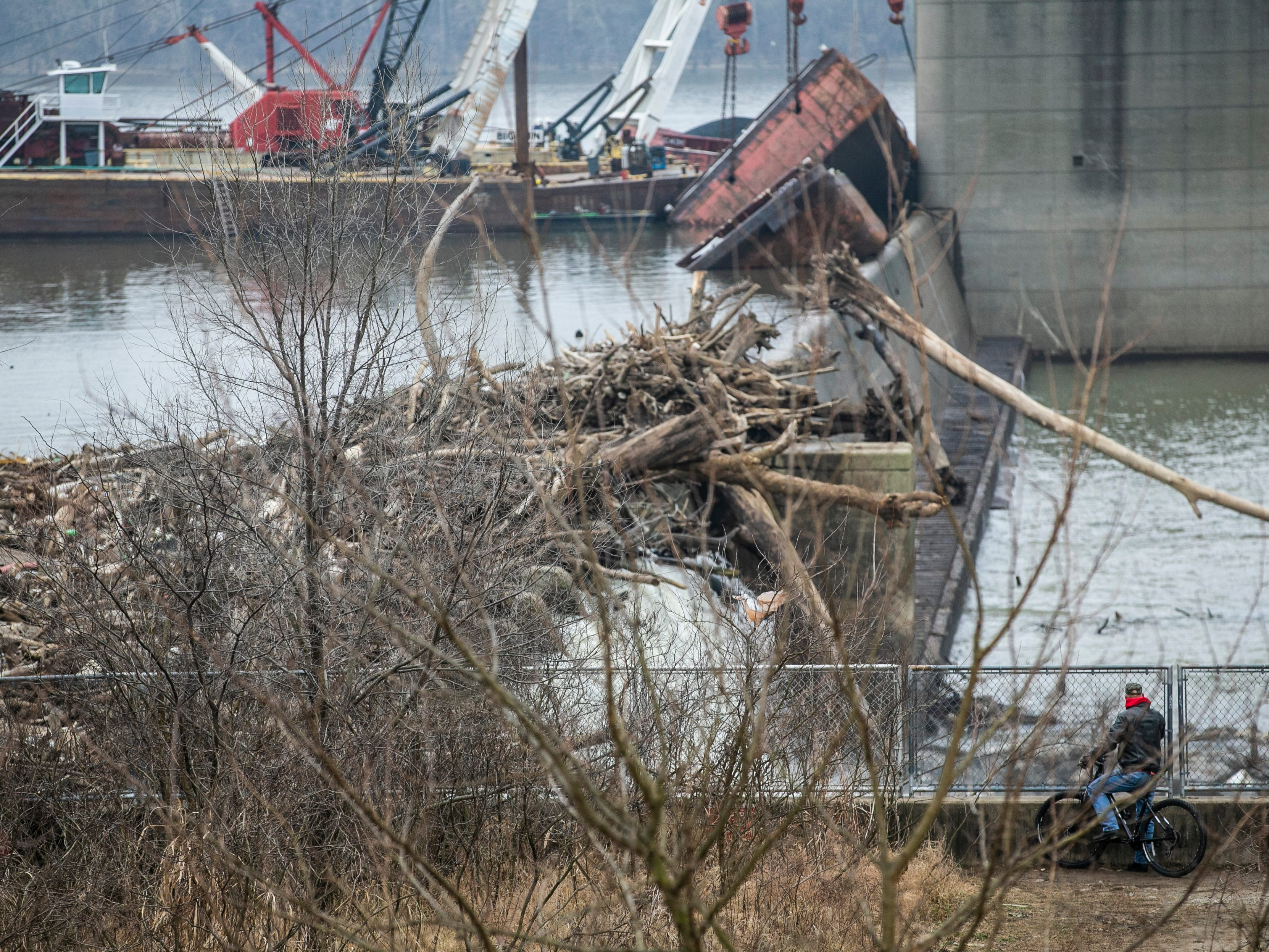 Work still continues on barge recovery near the dam at the Falls of the Ohio Wednesday, January 16, 2019.