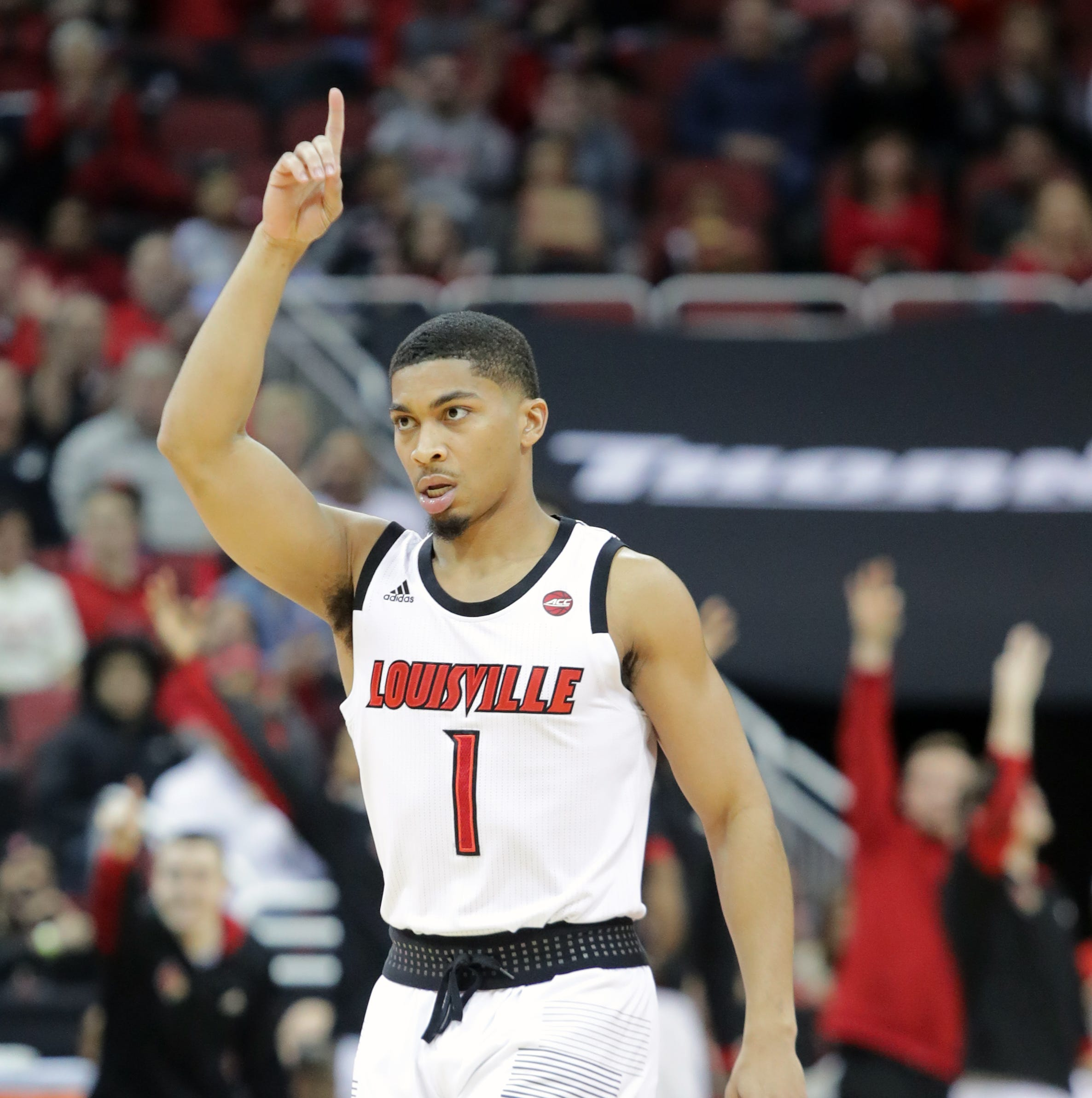 Louisville's Christen Cunningham celebrates after...