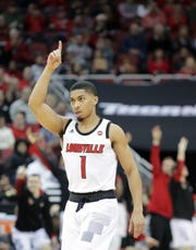 Louisville's Christen Cunningham celebrates after knocking down a three.