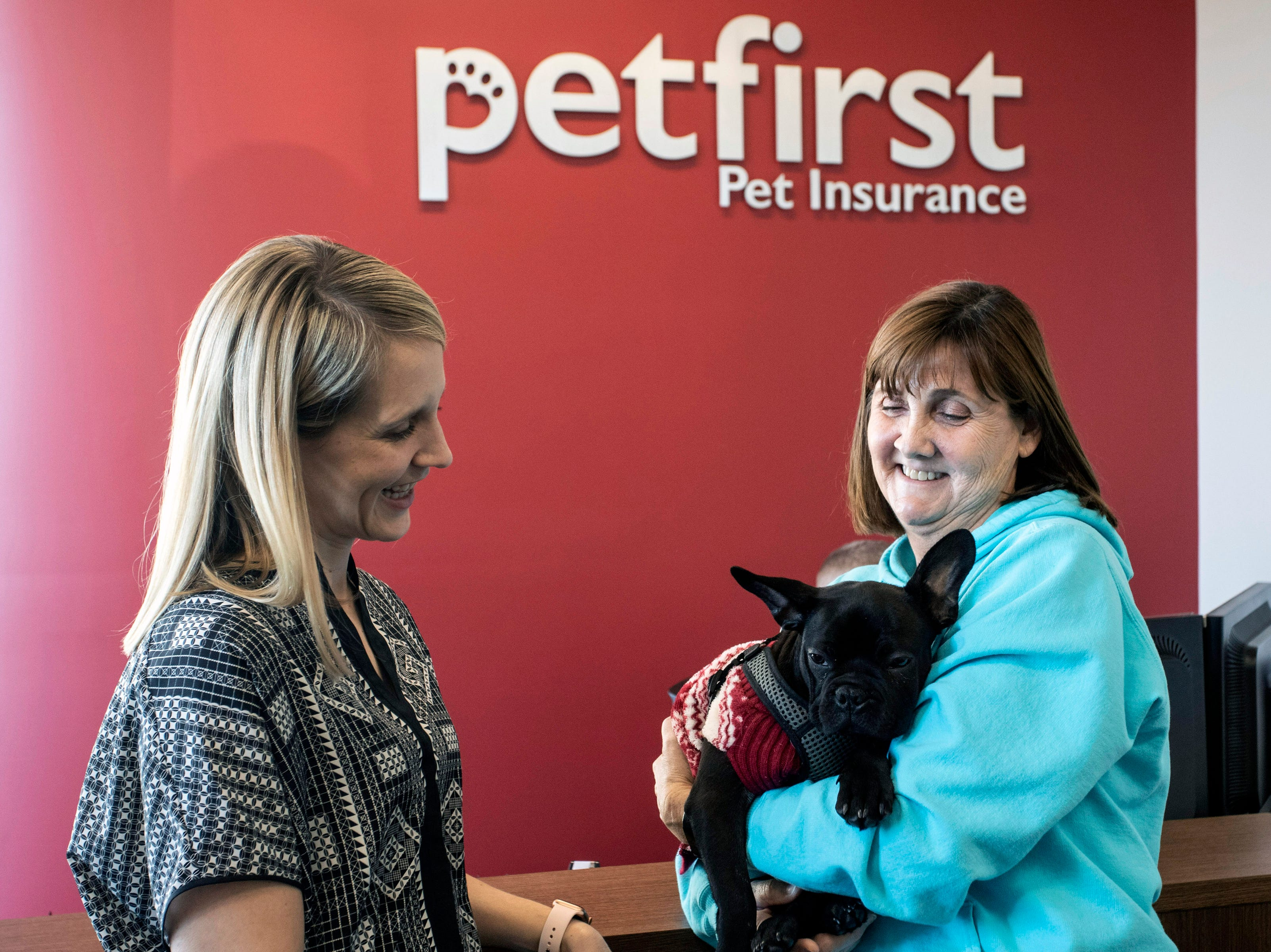 Lisa Recker and her French bulldog Winston are greeted by Katie Blakeley in the lobby of PetFirst in Jeffersonville. Jan. 10, 2019