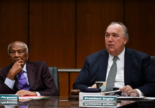 Former MSU interim President John Engler, right, pictured alongside trustee Joel Ferguson Friday, Oct. 26, 2018, during the MSU Board of Trustees Meeting at the Hannah Administration building.