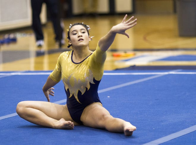Grand Ledge sophomore Tiana Seville performs her floor routine during Saturday's East Lansing Szapula Gymnastics Invitational on Jan. 4, 2013. Seville was killed when her moped was struck last month by Michigan State University salt truck.