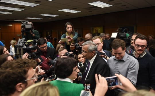 Members of the media gather around newly-named acting president of MSU Satish Udpa, following the Board of Trustees meeting at MSU Thursday morning, Jan. 17, 2019.