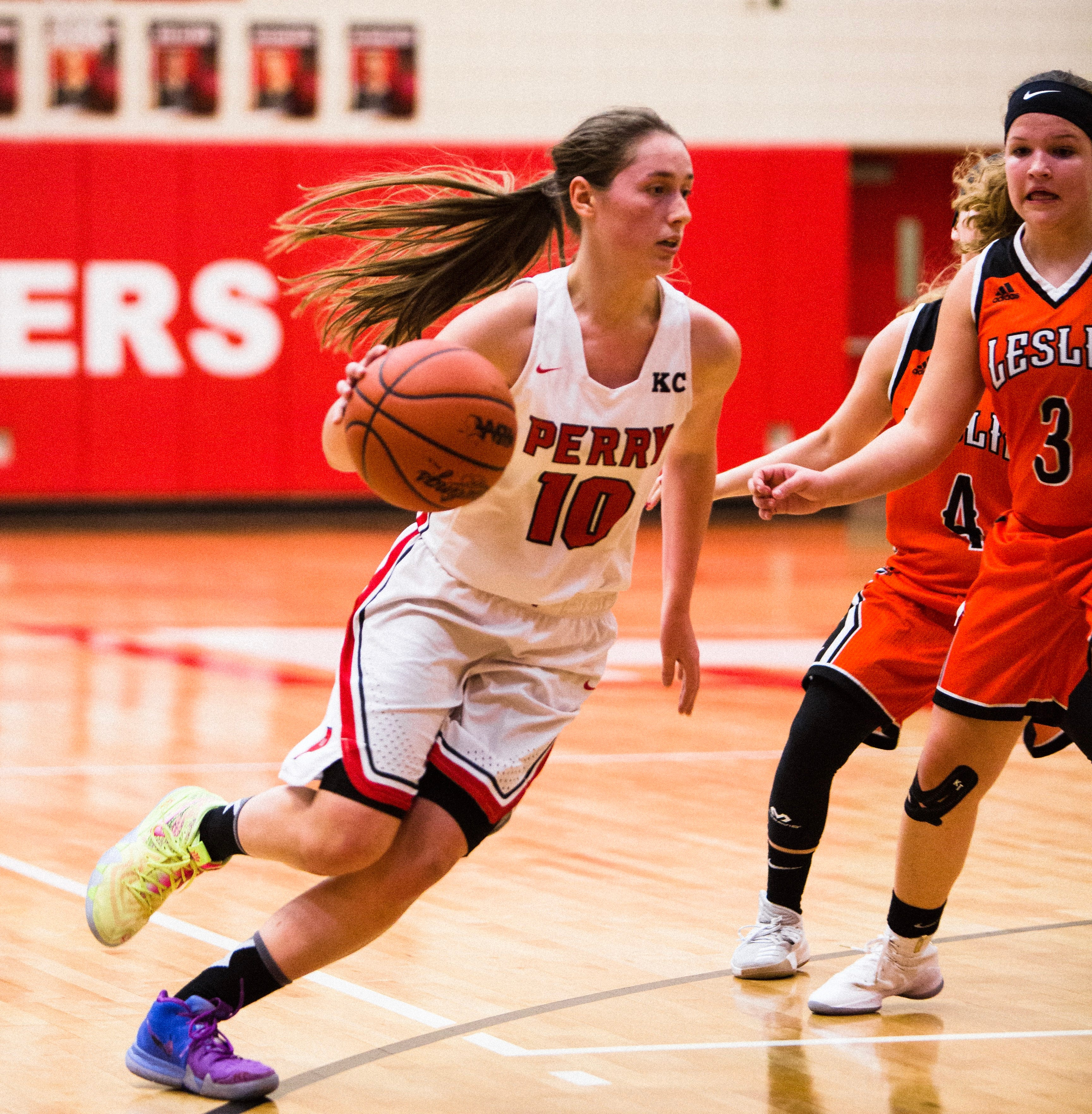 Perry's Alyssa Welsh  drives to the basket during a game against Leslie in February 2018..