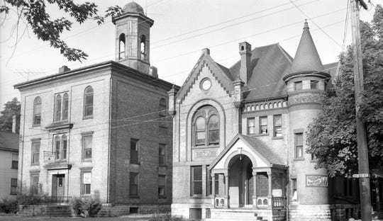 Old Manitowoc County Jail and Courthouse, 1024 and 1028 S. Eighth St., Manitowoc. Photograph taken on July 20, 1961. The former courthouse is on the left, former jail on the right. The buildings were demolished to build a new jail and traffic center.