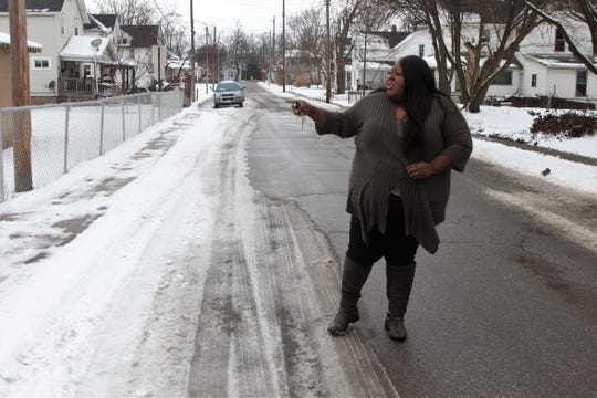 Aurea Deas points to a side entrance of the Martin Luther King Jr. Park on Wednesday. Her grandfather, who lives on the street, joined a group of residents in getting the park built in the west end of town in the 1980s. Now the street, Cass Avenue, will be renamed to honor King and his legacy.