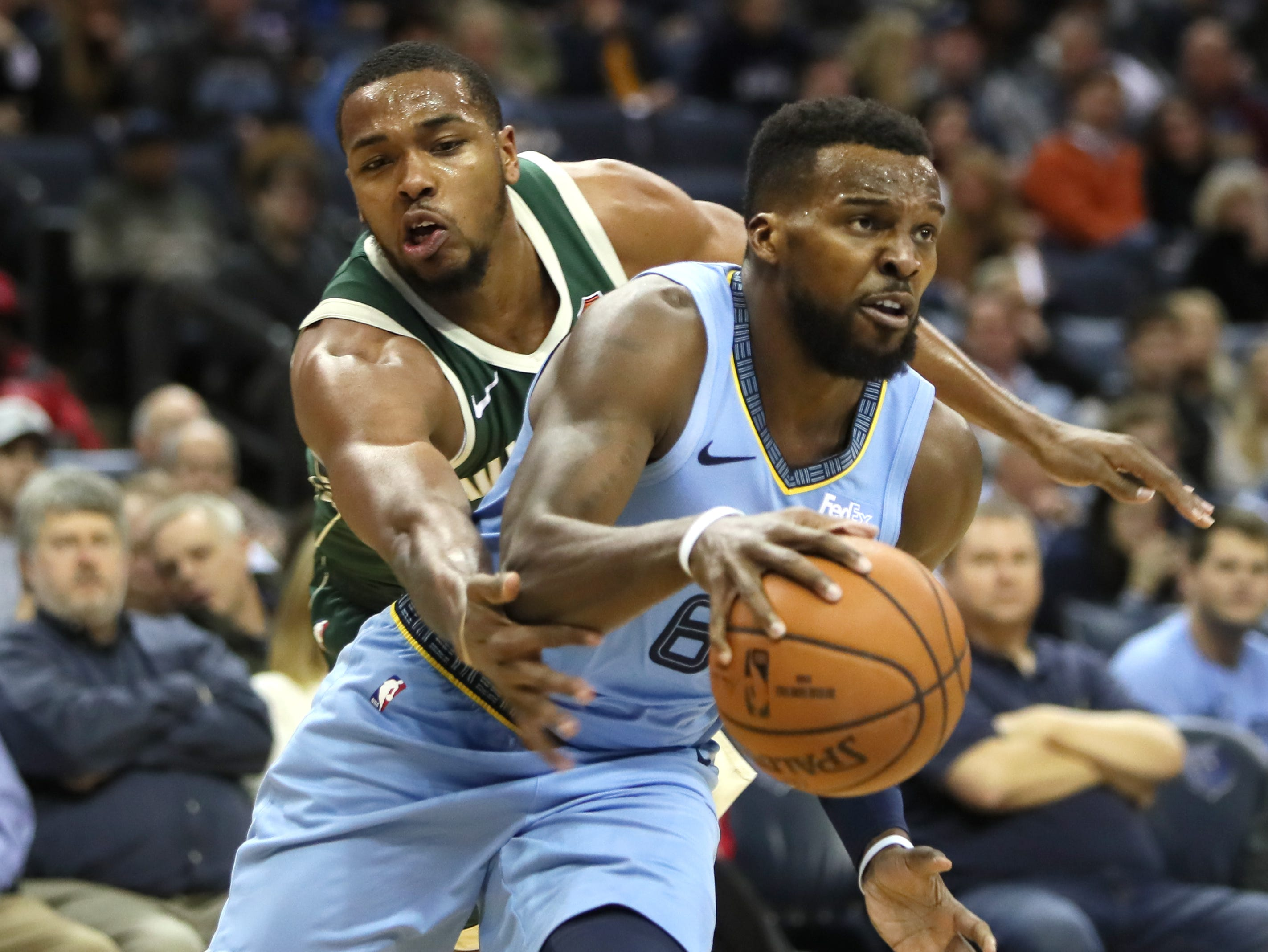 Memphis Grizzlies guard Shelvin Mack drives past the defense of Milwaukee Bucks guard Sterling Brown during their game at the FedExForum on Wednesday, Jan. 16, 2019.