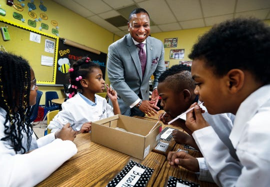 Dr. Joris Ray, superintendent of Shelby County Schools, chats with students at John P. Freeman Optional School, where he was once a student.