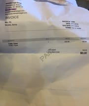 An invoice that Sarvia Morales paid to Memphis Legal Group, or Abogados, to help settle driving-related charges.