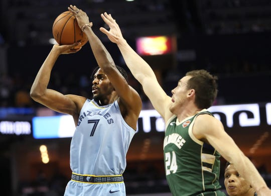 Memphis Grizzlies forward Justin Holiday shoots the ball over Milwaukee Bucks guard Pat Connaughton during their game at the FedExForum on Wednesday, Jan. 16, 2019.