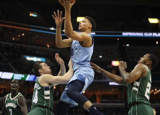 Memphis Grizzlies forward Ivan Rabb shoots the ball over Milwaukee Bucks guard Pat Connaughton during their game at the FedExForum on Wednesday, Jan. 16, 2019.